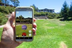 Pokemon GO App Showing Pokemon Encounter. APTOS, CALIFORNIA - JULY 11, 2016: The hit augmented reality smartphone app Pokemon GO shows a Pokemon encounter Royalty Free Stock Image