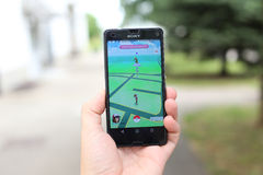Pokemon Go App. VELIKA GORICA, CROATIA- JULY 15, 2016 : A gamer using a smartphone to play Pokemon Go in Velika Gorica, Croatia. Pokemon Go is a free-to-play Royalty Free Stock Photo