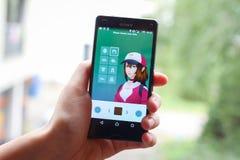 Pokemon Go App. VELIKA GORICA,CROATIA- JULY 15,2016 : A gamer using a smartphone to play Pokemon Go in Velika Gorica, Croatia. Pokemon Go is a popular free-to Stock Image