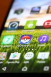 Pokemon Go App. VELIKA GORICA, CROATIA- JULY 15, 2016 : Macro close up image of Pokemon Go game app icon among other icons on a smartphone device. Pokemon Go is Stock Photos