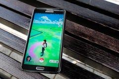 Pokemon Go application on the smartphone Stock Photography