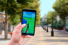 Pokemon Go application on the smartphone Stock Image