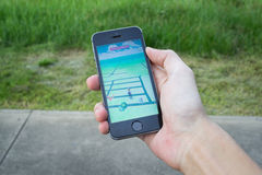 Pokemon Go. Bangkok, Thailand - July 12, 2016 : Apple iPhone5s held in one hand showing its screen with Pokemon Go application Stock Images