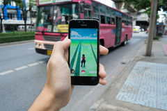 Pokemon Go. Bangkok, Thailand - July 19, 2016 : Pokemon Go is a new augmented reality game which lets you walk in the real world to catch the Pokemon Royalty Free Stock Photos