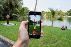 Pokemon Go. Bangkok, Thailand - July 22, 2016 : Pokemon Go is a new augmented reality game which lets you walk in the real world to catch the Pokemon Stock Images