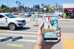 Pokemon GO Be Aware Loading Screen. SANTA CRUZ, CALIFORNIA - AUGUST 2, 2016: A person views the loading screen of the hit smartphone app Pokemon GO, which urges stock photography