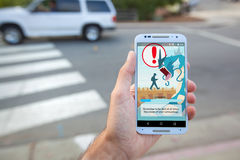 Pokemon GO Be Aware Loading Screen. SANTA CRUZ, CALIFORNIA - July 15, 2016: A person views the loading screen of the hit smartphone app Pokemon GO, which royalty free stock photos