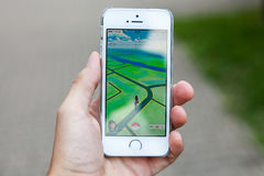 Pokemon Go game on screen of iPhone Stock Photo