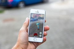 Pokemon Go game on screen of iPhone Royalty Free Stock Photo