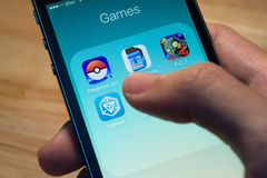 Pokemon Go, Ingress and other popular game application icons Royalty Free Stock Image