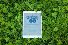 Pokemon Go on iPad. TRIM, IRELAND - JULY 18, 2016: Pokemon Go app on iPad Air. Pokémon Go is a popular location-based augmented reality mobile game developed by Royalty Free Stock Photography