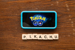 Pokemon Go. Kuala Lumpur,Malaysia 25th July 2016, smartphone with pokemon go logo on the screen with pikachu word Royalty Free Stock Photos