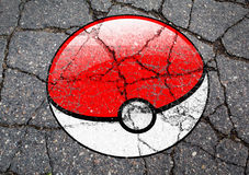 Pokemon GO logo ball drawn on asphalt. Most famous smartphone game pokemon go logo on concrete background royalty free stock photos