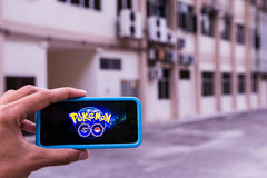 Pokemon Go. MALACCA, MALAYSIA - JULY 13TH, 2016 : An IOS user plays Pokemon Go, a free-to-play augmented reality mobile game developed by Niantic for iOS and Royalty Free Stock Photography