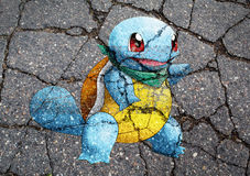 Pokemon GO monster drawn on asphalt Stock Photo