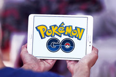 Pokemon go. Most famous smartphone game pokemon go icon on white tablet in hands.this game is travel between the real world and the virtual world of Pokémon Stock Photography