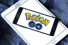 Pokemon go. Most famous smartphone game pokemon go logo on mobile phone. this game is travel between the real world and the virtual world of Pokémon Stock Image