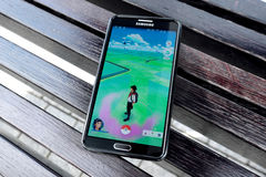 Pokemon Go is a new augmented reality game which lets you walk i Stock Photography