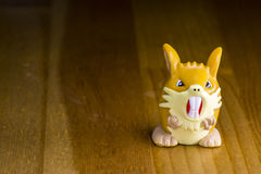 Pokemon go. Some pokemon go miniatures on wooden background stock photo