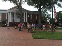 Pokemon Go walk. Downtown statesville at Mitchell community college. Friends and family gathered together to join forces and catch Pokemon in groups. Public Royalty Free Stock Photography