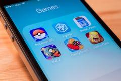 Pokemon Iść, ingres i inne popularne gemowe podaniowe ikony obrazy stock
