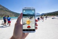 Pokemon IŚĆ spotkanie przy Jeziornym brzeg Zdjęcie Stock