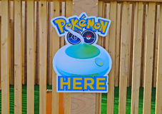The pokemon sign hanging on one of the public institutions. Pokemon, this free game is an augmented reality mobile game developed. Saint Petersburg, Russia Stock Photography