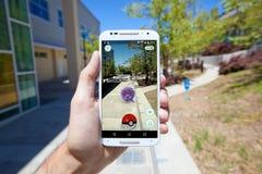 Pokemon VA ad una città universitaria dell'istituto universitario Fotografia Stock Libera da Diritti