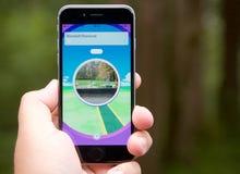 Pokemon vont APP montrant un arrêt de poussée Photos stock