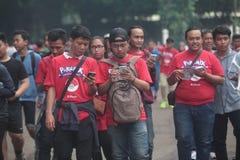 Pokemon vont entraîneur en Indonésie Image stock