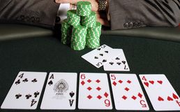 Poker 061. A poker player with his chips and cards Stock Images