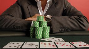 Poker 07. A poker player with his chips and cards Stock Photo