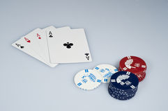 Poker. Axis boards and chips on white background royalty free stock photo