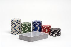Poker. Deck of cards and poker chips royalty free stock photography