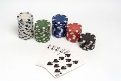 Poker. Royal straight flush poker hand with chips stock photography