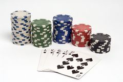 Poker. Royal straight flush poker hand with chips stock photos