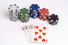 Poker. Three of a kind poker hand with chips stock image