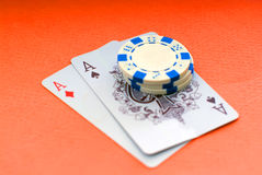 Poker. Cards, two aces and chips on red background Stock Photo