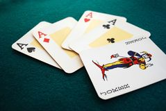 Poker. The four aces from a deck of poker. With a wildcard. Five cards Stock Image
