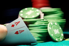 Poker. Pair of aces and poker chips on a green table in casino Royalty Free Stock Images