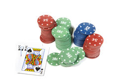 Poker. Pair of kings and poker chips on a white table Royalty Free Stock Photos