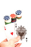 Poker 2. Woman hand holding poker king cards and chips on white background Stock Photography