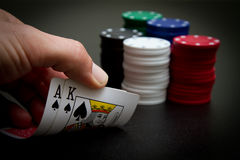 Poker. Or gambling hand with  chips, luck of the draw Royalty Free Stock Photography