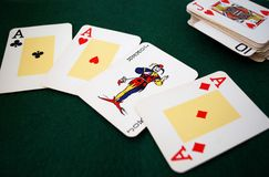 Poker. A deck of poker. Poker cards with three aces and a joker foreground Stock Photography