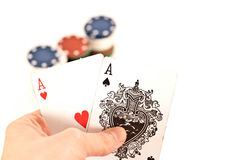 Poker. Woman hand holding poker king cards and chips on white background Royalty Free Stock Photography
