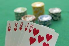 Poker. Royal flush and gambling chips Royalty Free Stock Image