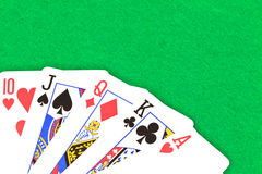 Poker. Cards with straight to ace. Over green card table felt Royalty Free Stock Photo