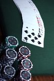 Poker 6. Poker chips in different colours on green background with playing cards Stock Images
