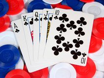Poker. A poker hand on a pile of poker chips Royalty Free Stock Photos