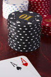Poker. Texas hold'em hole cards with chip stack Stock Photography